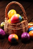 Basket of Easter eggs on table. easter decoration. Basket of Easter eggs on table. colorful easter decoration royalty free stock images