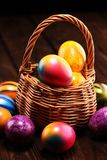Basket of Easter eggs on table. easter decoration. Basket of Easter eggs on table. colorful easter decoration stock image