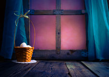 Basket Easter eggs table window Royalty Free Stock Image