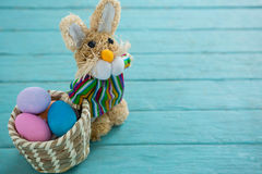 Basket with Easter eggs and toy Easter bunny Stock Photos