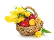 Basket with easter eggs and tulips Royalty Free Stock Photography