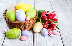 Basket with easter eggs and tulips Royalty Free Stock Photo