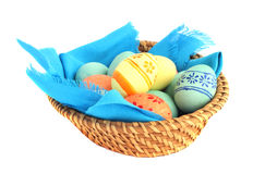 Basket of easter eggs on white Royalty Free Stock Photography