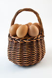 Basket with eggs. On a white background Stock Photos