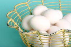 Basket of eggs. Vintage yellow basket of eggs royalty free stock images