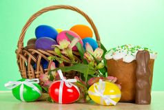 Basket, eggs, an Easter cake, rabbit, alstromeria Stock Images