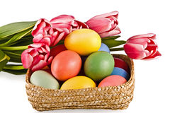 Basket with eggs and flowers Stock Images