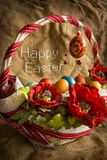Basket with eggs and greeting Happy Easter. Embroidered on the burlap stock photos