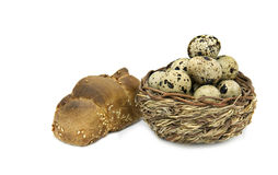 Basket with eggs and loaf of bread Stock Images