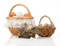 Basket with eggs and quail eggs Stock Image
