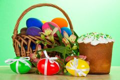 Basket, eggs with ribbons, an Easter cake Stock Images