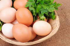 Basket with eggs on sackcloth Stock Photography