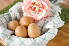 Basket of eggs on table Stock Photography