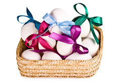 Basket with eggs, on a white Stock Images