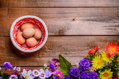 Basket with eggs on wooden table. Background. Copy spase right. Royalty Free Stock Photography