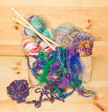 Basket with fancy art yarns Stock Images