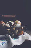 Basket with farmers eggs on dark background Royalty Free Stock Images