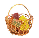Basket filled with candy. On a white background Royalty Free Stock Photos