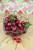 Basket filled with cherries Royalty Free Stock Images