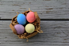 Basket filled with colorful Easter eggs Royalty Free Stock Photo