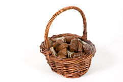 Basket filled with delicious chocolates. Over white stock photography