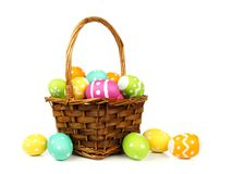 Basket filled with easter eggs Royalty Free Stock Photo