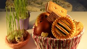 Basket filled with eggs and cookies for Easter stock footage