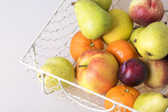 Basket filled with fresh fruits Royalty Free Stock Photos