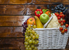 A basket filled with fruits and vegetables. Healthy fruits and vegetables in an basket Stock Image