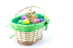 Basket filled with green cloth and fake grass with Easter Bunny Royalty Free Stock Image