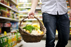 Basket filled healthy food. Supermarket: man holding a basket filled healthy food Stock Images