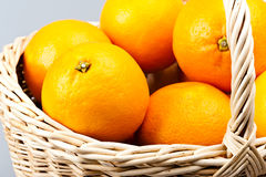 Basket filled with oranges Stock Photo
