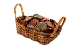 Basket filled with US coins isolated on white. Small wicker basket filled with US coins isolated on white. Shallow DOF. Focus on coins Stock Photography