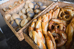 Basket filling with delicious bread and pretzel Royalty Free Stock Images