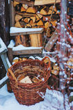 Basket with fire wood near wooden shed in winter Stock Photography