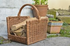 Basket with firewood in a garden Royalty Free Stock Photography