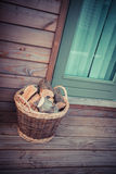 Basket of firewood on the porch Stock Photo