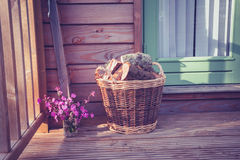 Basket of firewood on porch Stock Image
