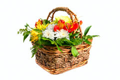 Basket with flowers. Basket with colourfull flowers isolated on white Stock Photo