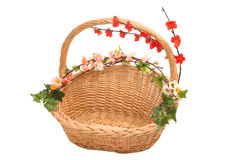 Basket with flowers. A basket with spring flowers royalty free stock photo