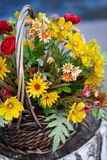 Basket with flowers. Basket of flowers on the sea shore Royalty Free Stock Images
