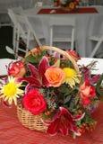 Basket of flowers stock photos