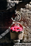 Basket of flowers on ancient artifact. In florence Stock Photo