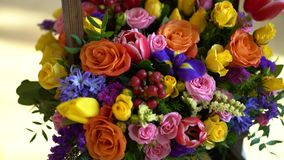Basket of flowers, bright colors, roses and tulips. Basket of flowers, bright colors, roses and tulips stock footage