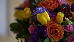 Basket of flowers, bright colors, roses and tulips. Basket of flowers, bright colors, roses and tulips stock video footage