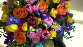 Basket of flowers, bright colors, roses and tulips. Basket of flowers, bright colors, roses and tulips stock video