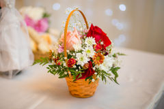 Basket of flowers on decorated table Royalty Free Stock Photography