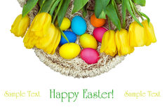 The basket with flowers and Easter eggs Stock Photos