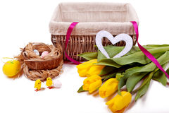Basket with flowers and eggs from chickens Stock Image