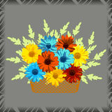 Basket with flowers. Gerberas and chamomiles on grey background. Royalty Free Stock Photo